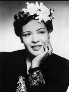 black and white picture of billie holiday with white flower in her hair